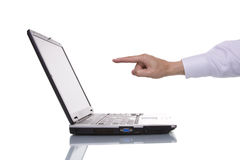 Businessman hand pointing. To the laptop Royalty Free Stock Image