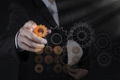 Businessman hand pointing to gear to success Stock Photography