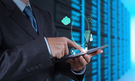 Businessman hand pointing to padlock. On touch screen computer as Internet security online business concept Stock Photo