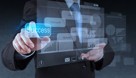 Businessman hand pointing to success diagram Royalty Free Stock Photo