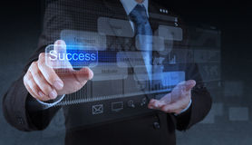 Businessman hand pointing to success diagram Stock Images