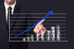 Businessman hand pointing on a virtual graph column Stock Photography