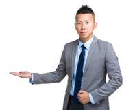 Businessman with hand presentation Royalty Free Stock Photos