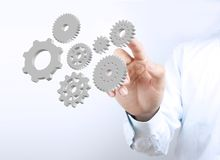 Businessman hand press gears Royalty Free Stock Images