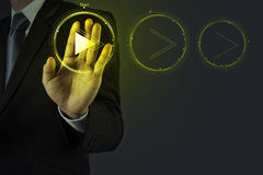 Businessman hand press play button sign to start. Or initiate projects as concept Royalty Free Stock Image