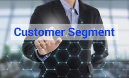 Businessman hand pressing button customer segment. Sign on virtual screen. business concept Royalty Free Stock Image