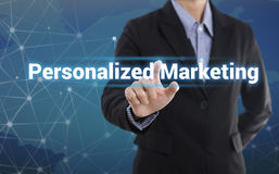 Businessman hand pressing button personalized marketing. Sign on virtual screen. business concept Stock Image