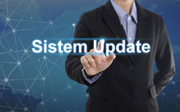 Businessman hand pressing button sistem update. royalty free stock photo