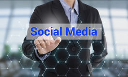 Businessman hand pressing button social media. Stock Photo