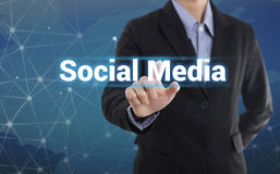 Businessman hand pressing button social media. Stock Photos