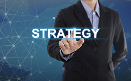 Businessman hand pressing button strategy. Stock Images