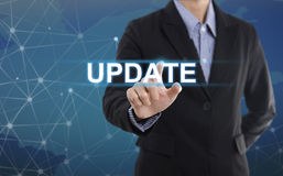 Businessman hand pressing button update. Sign on virtual screen. business concept Stock Photo