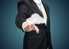 Businessman hand pressing cloud icon on concept for cloud comput Stock Photography