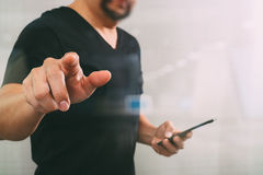 Businessman hand pressing an imaginary button,holding smart phon Royalty Free Stock Photos