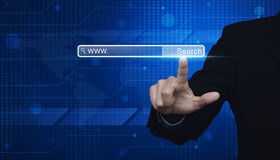 Businessman hand pressing search www button on digital world map Stock Photography