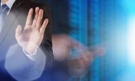 Businessman hand pressing a touchscreen button. On server background Stock Photos