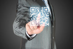 Businessman with hand pressing virtual qr code Stock Photography