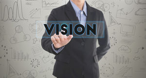 Businessman hand pressing wording key to vision. Stock Image