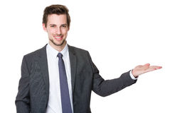 Businessman with hand promote something Stock Images