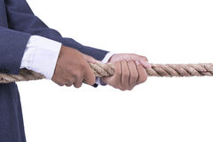 Businessman hand pulling the rope on white background. Businessman hand pulling the rope stock photo
