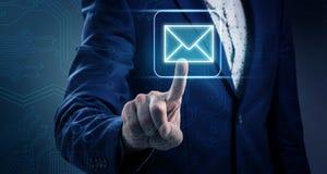 Businessman hand pushes on luminous email icon foto de archivo