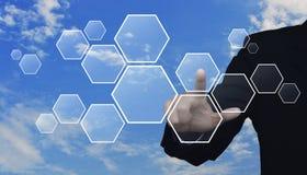 Businessman hand pushing blank hexagon shape Royalty Free Stock Image