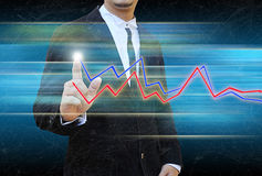 Businessman hand pushing a business graph Stock Photo