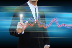 Businessman hand pushing a business graph Royalty Free Stock Photos
