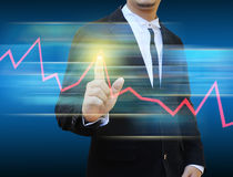 Businessman hand pushing a business graph Royalty Free Stock Photo