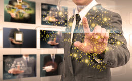Businessman hand pushing button on a touch screen interface Stock Photos