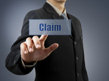 Businessman hand pushing Claim button Royalty Free Stock Photo