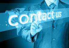 Businessman hand pushing contact us button stock photos