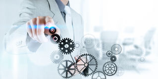 Businessman hand pushing gear to success concept Royalty Free Stock Photo