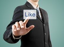 Businessman hand pushing Like button Stock Photography