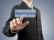Businessman hand pushing opportunity button Stock Photos
