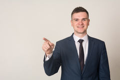 Businessman hand pushing screen on light background.  Royalty Free Stock Images