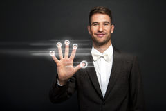 Businessman hand pushing screen Stock Image
