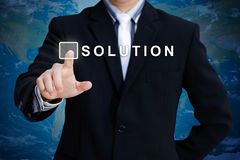 Businessman hand pushing solution Stock Image