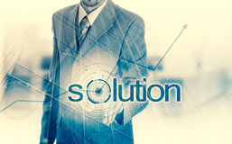 Businessman hand pushing solution button on a touch screen interface Royalty Free Stock Images