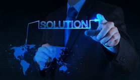 Businessman hand pushing solution graph on a touch screen Stock Images