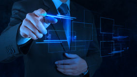 Businessman hand pushing on a touch screen Royalty Free Stock Photos