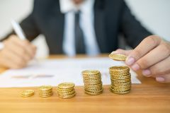 Businessman Hand Put Coins. To Stack Of Coins Stock Images