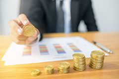 Businessman Hand Put Coins. To Stack Of Coins Stock Image