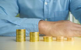 Businessman Hand Put Coins To Stack Of Coins Royalty Free Stock Photography
