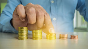 Businessman Hand Put Coins To Stack Of Coins Royalty Free Stock Images