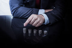 Businessman Hand Put Coins To Stack Of Coins Royalty Free Stock Photos