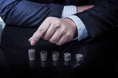 Businessman Hand Put Coins To Stack Of Coins Stock Photos