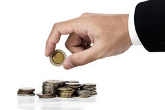 Businessman hand putting money coins, saving money concept, isolated on white background royalty free stock photography