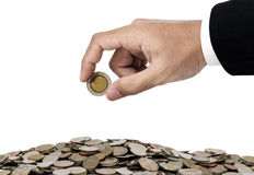 Businessman hand putting money coins, saving money concept, isolated on white background Stock Photography