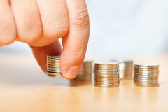 Businessman hand reaching for pennies. Businessman reaching for pennies, financial crisis concept stock image